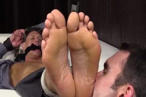 Bryce Evans Is fastened Up And Has His Toes Licked On The bed