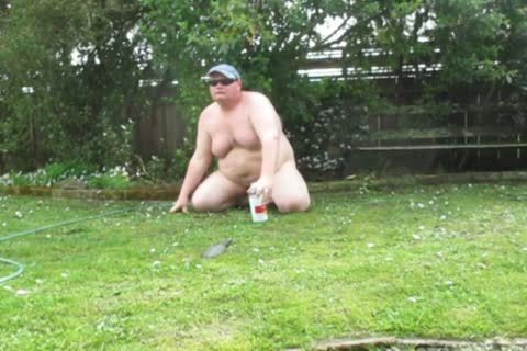 bulky man Playing In The Mud outdoors