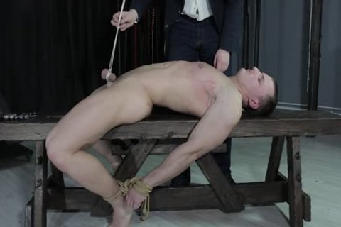 stunning lad fastened Down, Balls Strung Up And Spanked