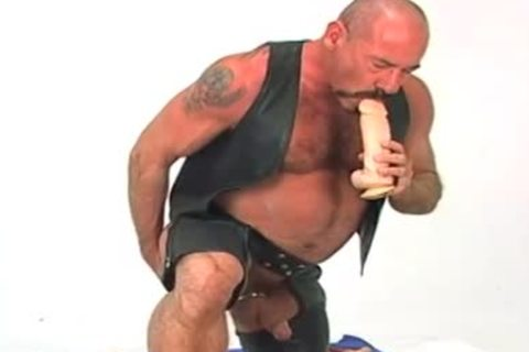 Butch leather wearing daddy man w/ large sextoy